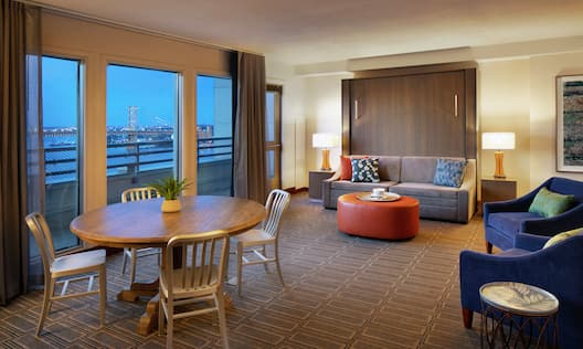 Suite Living Area with Sofa and Table with Chairs