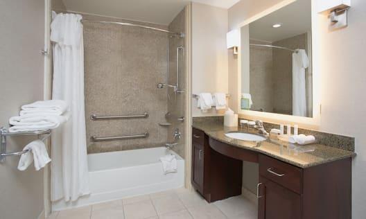 Bathroom with shower, tub, and bathroom amenities