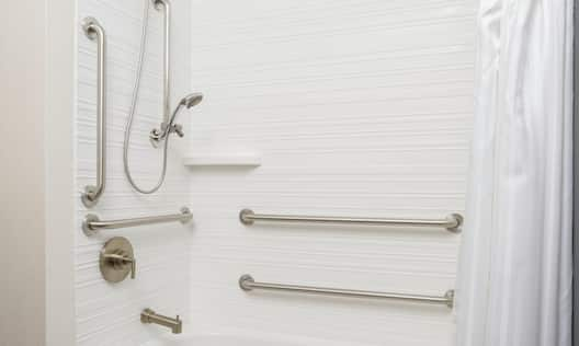 Accessible shower with handrails
