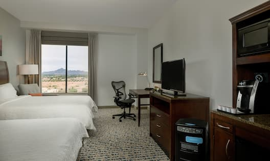 Double Queen Guest Room with Work Desk, Television and Amenities