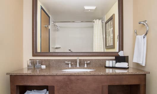Suite Bathroom Vanity, Sink, and Mirror,  with Towels and Toiletries
