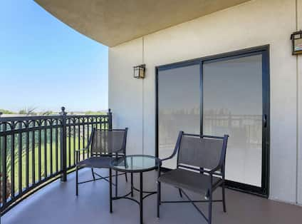 Table and two chairs in guest room balcony