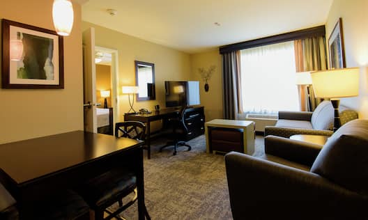 Suite Living Area with TV Desk and Sofa