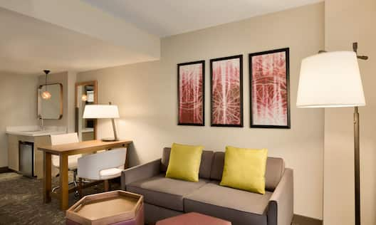 Guest Living Room with Sofa, Work Desk and Beverage Station