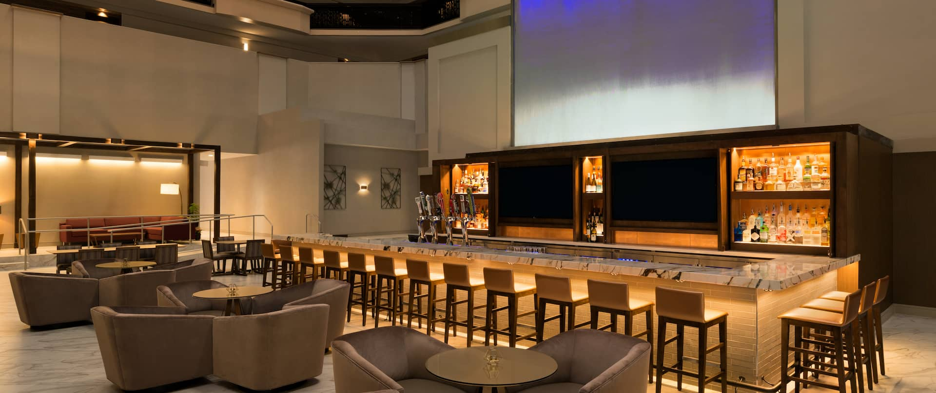 Bar Lounge Seating Area with Bar Counter and Bar Stools