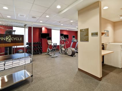 Fitness Room with Workout Equipment and Guest Washer and Dryer