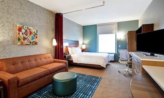 Studio Suite with Queen Bed, Sofa, Work Desk, and HDTV