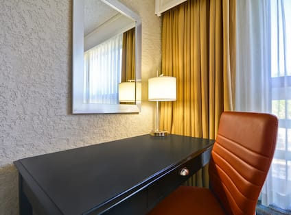 Hotel Room with Desk and Ergonomic Chair