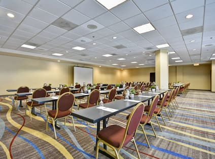A large room with long tables and chairs