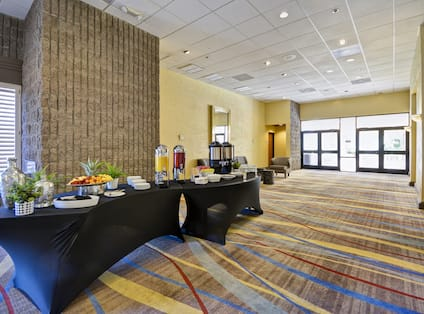 Foyer with long table and food