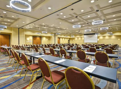 A room full of long tables and chairs