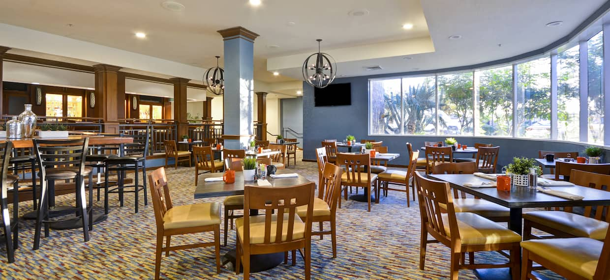 Wooden tables and chairs in a restaurant dining room