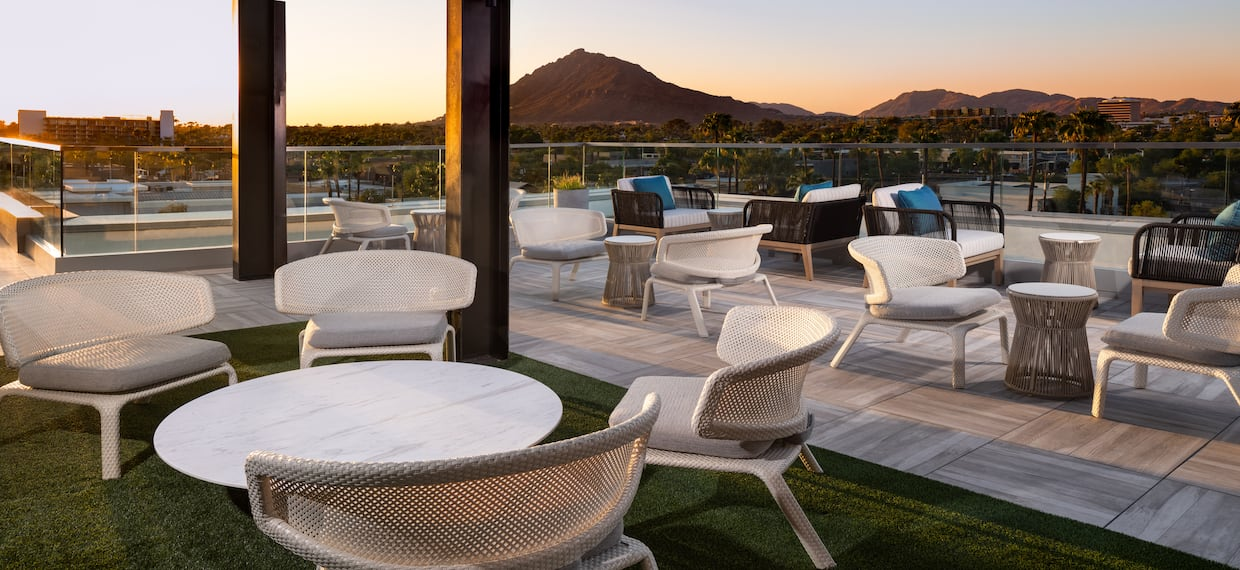 Seating Area on Hotel Terrace with View of Mountains