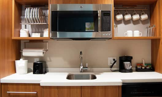 Kitchen with sink and microwave