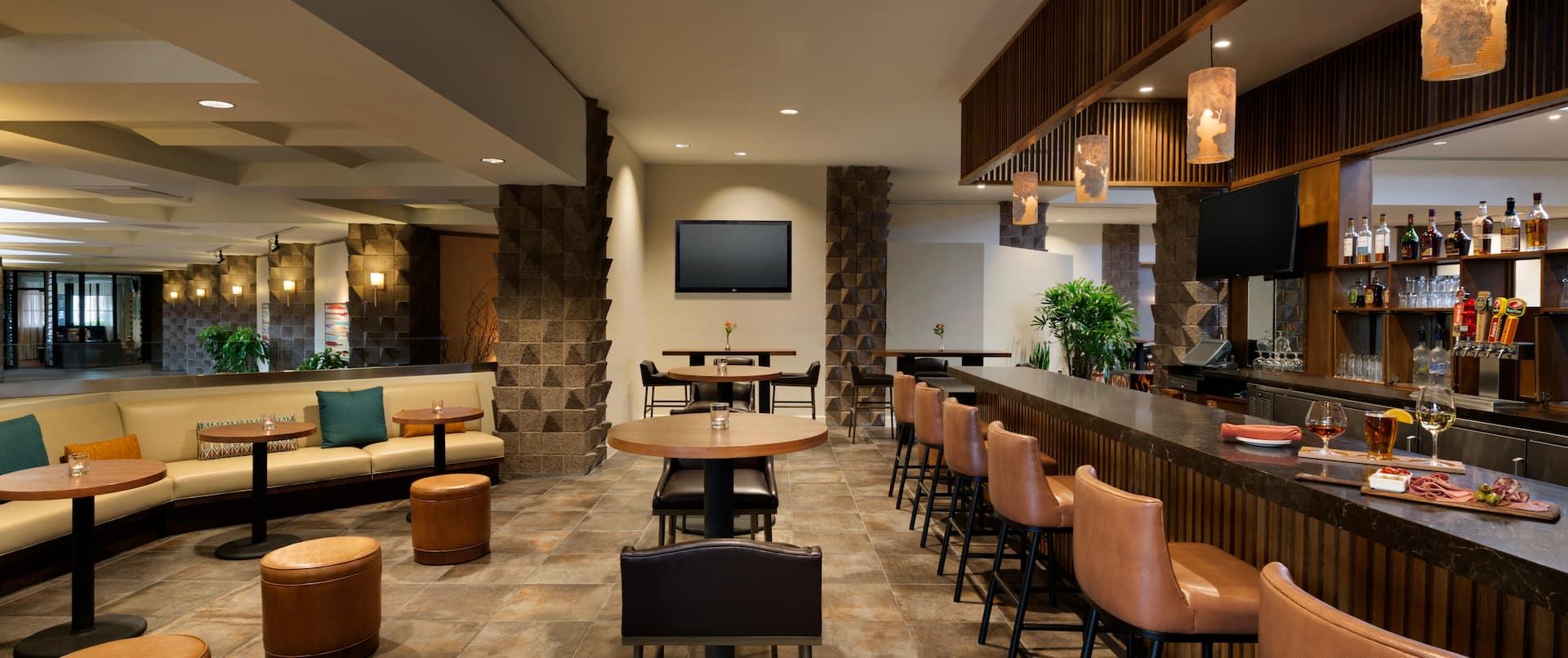 Lounge Seating, Cocktail Tables, TV, and Counter Seating at Well-Stocked Bar at Asadero Cocina & Cantina