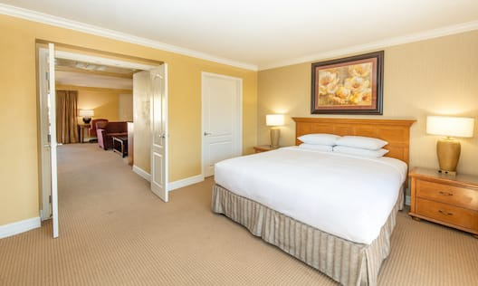 Bed in room with lamps