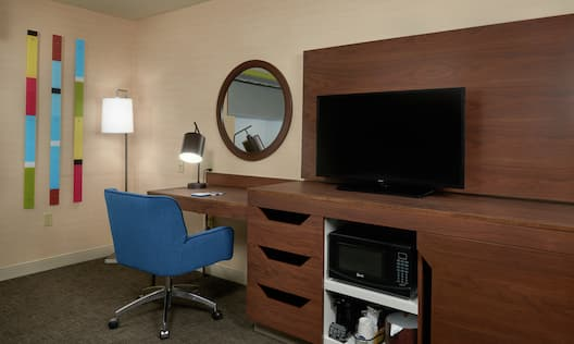Guestroom with TV, Microwave and Work Desk