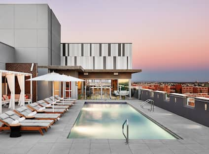 Rooftop pool with loungers