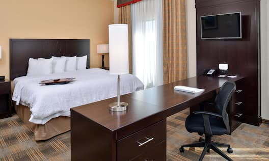 Studio Suite Bed HDTV and Desk Area