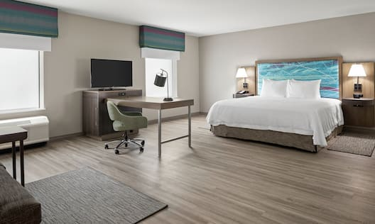 Guestroom with King Bed, Work Desk, and Television