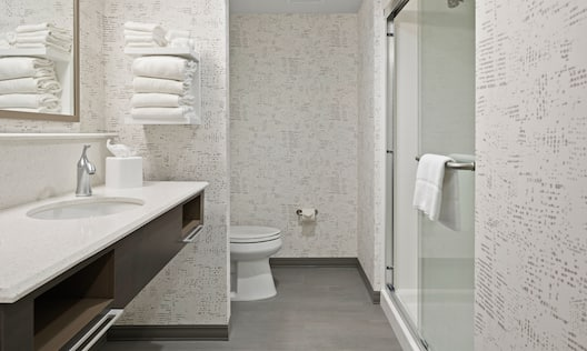 Guest Bathroom with Vanity and Walk In Shower