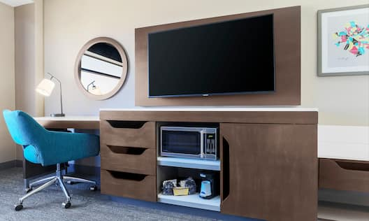 Bed in room with workdesk