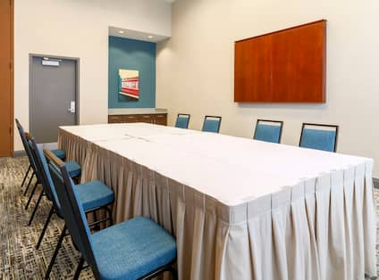 Meeting room with table and chairs
