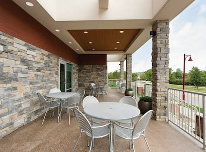 Outdoor Patio With Chairs Around Round Tables