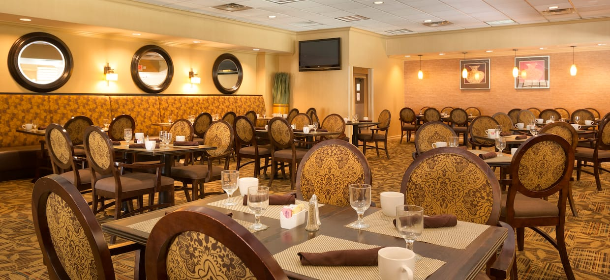 Maxwell's restaurant with dining tables, chairs, dining amenities, and TV