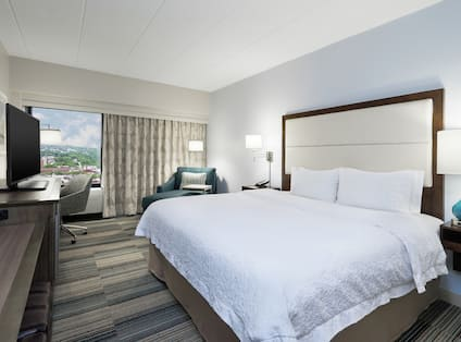 Deluxe Guestroom with King Bed, Room Technology, Lounge Area, Work Desk, and Outside View