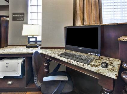 Business Center with Room Technology, Table, and Office Chair