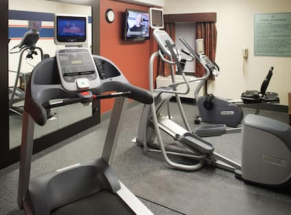 Fitness Center with Treadmill, Elliptical Machine, Room Technology, and Mirror