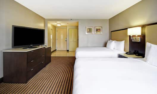 Guest Room with Two Queen Beds and Television