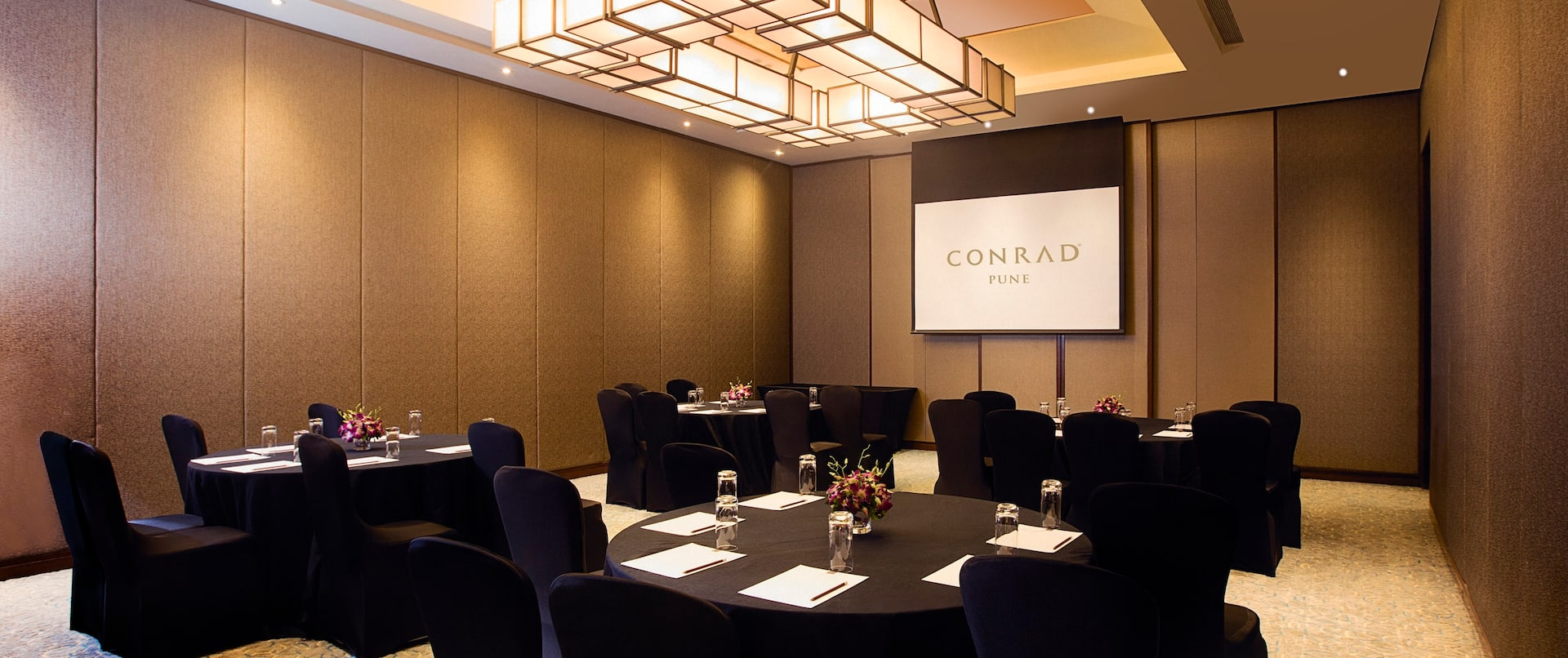 Aster Meeting Room Set up with Black Round Tables