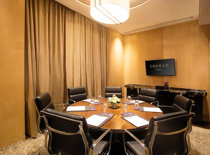 Lilac Meeting Room with Round Table Showing Seating for 7 Guests