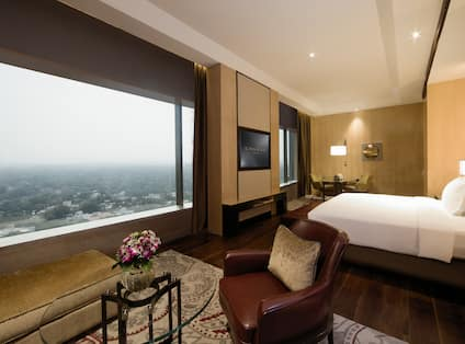 Hotel Bedroom with King sized Bed HDTV and Large Windows