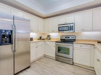 Suite kitchen with fridge, oven, stove, microwave, and coffee maker
