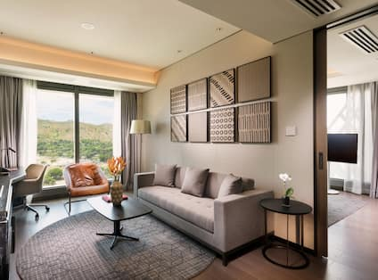 Executive Suite Living Area with Sofa, Armchair, Coffee Table, Work Desk and HDTV