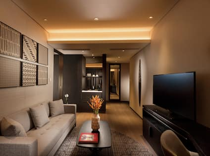Suite Living Area with Sofa, Coffee Table and HDTV