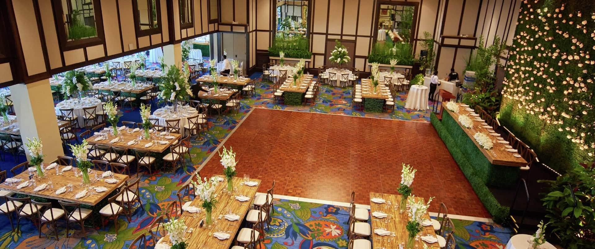 Grand Ballroom with Wedding Decor and Tables Around Dance Floor