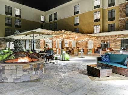 Patio at Night with Fire Pit and Lounge Seating