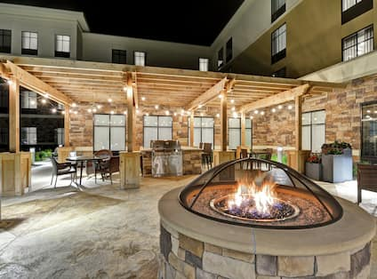 Outdoor Patio at Night with Fire Pit