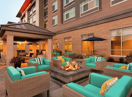 Outdoor Patio With Firepit at Dusk