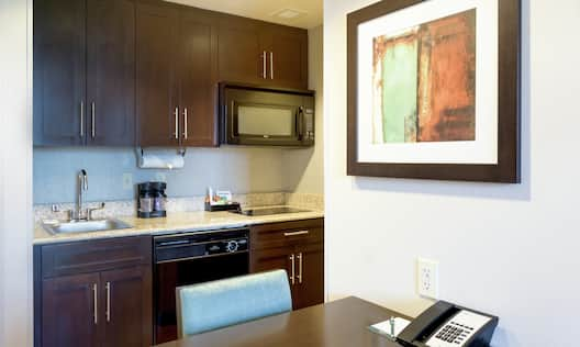 Kitchen Cabinets, Counters, and Dining Table in Suite