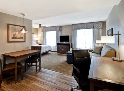 Studio Suite Dining Area, Lounge Area and King Bed
