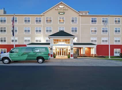 Hotel Exterior Building Front View with Hotel Shuttle