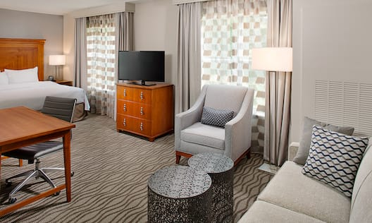 King Studio Suite with king bed, work desk, TV, and lounge sofa and chair