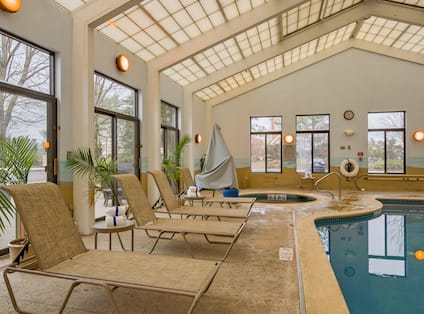 Indoor Pool and Hot Tub with Lounge Seats on Deck
