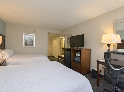 Guestroom with Two Queen Beds, Work Desk, Television, Microwave and Mini Fridge