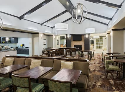 Lodge Seating Area with dining tables, breakfast serving area, TV, fireplace
